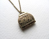 Movable purse locket necklace on long antiqued gold metal chain