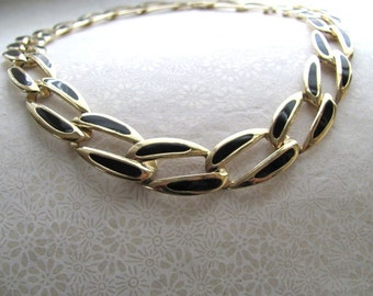Gold chain and black enamel choker