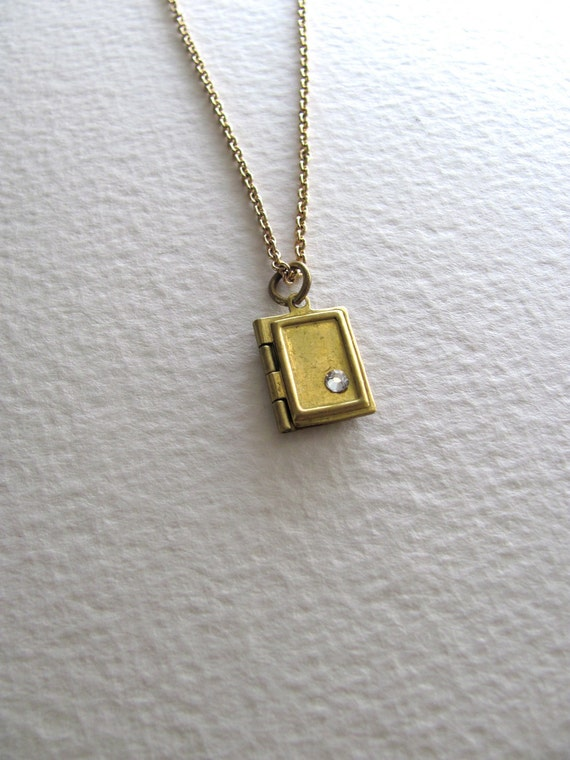 Tiny book locket necklace on antiqued gold metal chain, upcycled vintage jewelry