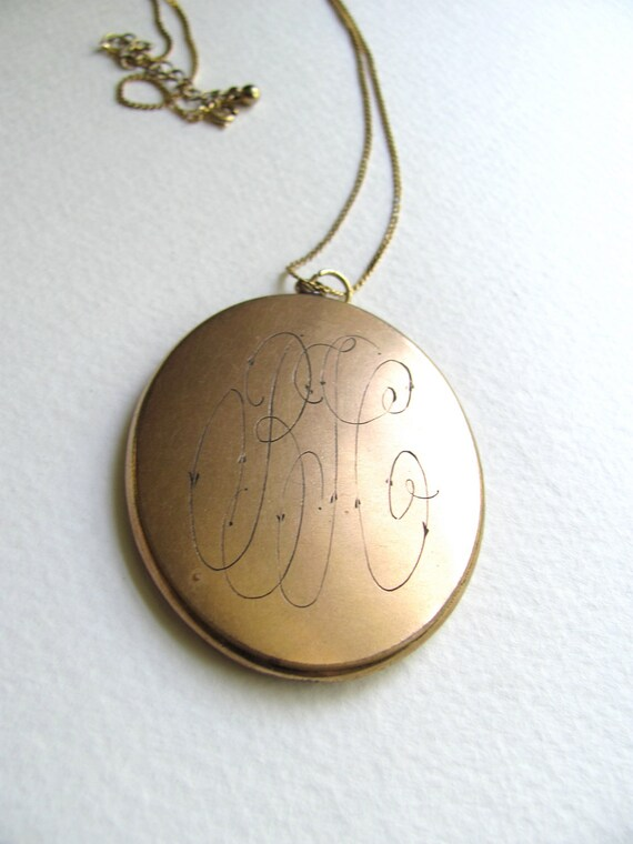 FOR KATHLEEN: Antique gold oval monogram locket on long chain, signed W & H Co.