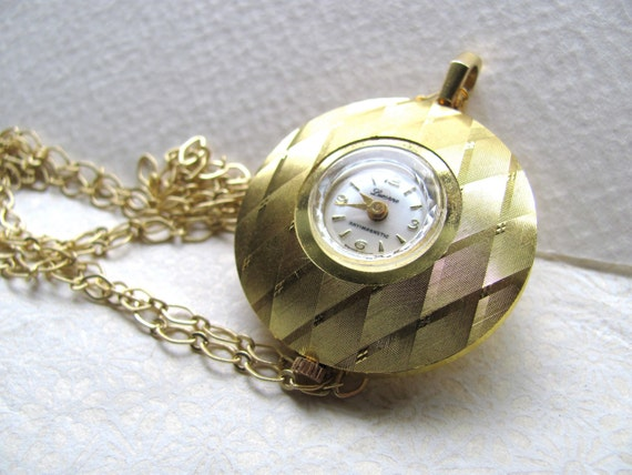 Gold tone vintage pocket watch pendant necklace by Lucerne, 1950s mid century modern
