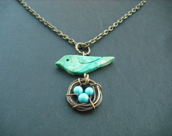 turquoise bird and nest necklace - antique brass