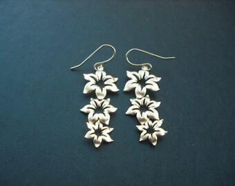 matte yellow gold triple star flower pendant earrings