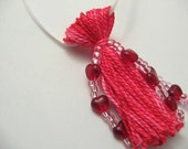 Valentine's Day Ornament: Pink Beaded Tassel covered in Red Hearts
