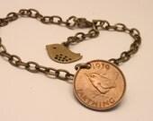 British coin bracelet with bird design.  Fabulous wren on brass chain