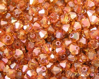 36 pcs CRYSTAL COPPER Swarovski Bicone Beads 5301 6mm Wholesale Destash