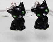 Black 3D black kitty cat earrings with green eyes