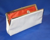 White Vinyl Clutch Hand Bag with Orange Lining and Tilt Closure