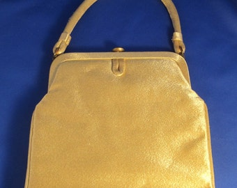 Slim and Shimmery Gold Garay Purse