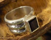 Sterling silver ring with garnet.