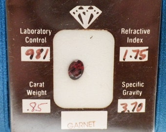0.85 CT Garnet Oval Shaped Loose Stone with Certificate and Folder