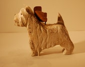carved west highland terrier