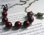 Vintage Look Burgundy Swarovski Pearls Hand Wrapped on Brass With Butterfly Detail