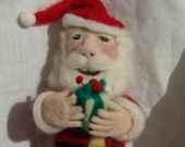 Santa Claus is needle felted from wool and ready for Christmas.