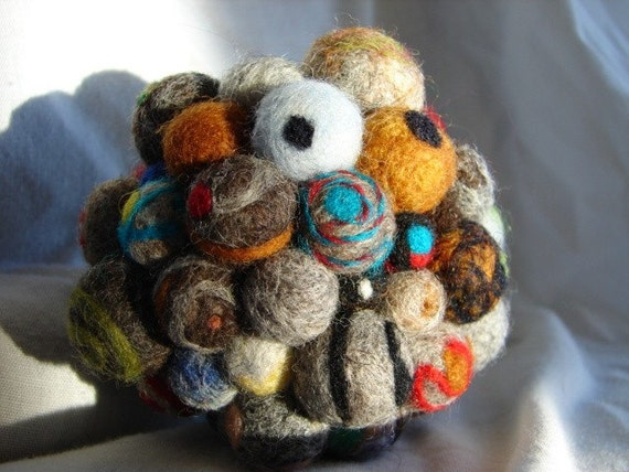 When worlds collide, this is a series of needle felted balls, each one different, then needle felted to each other
