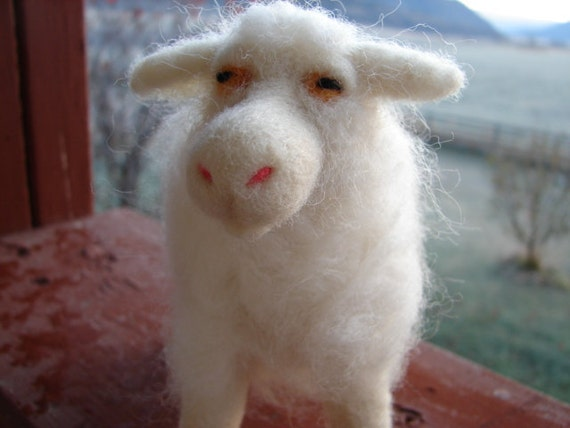 White sheep needle felted wool sculpture.