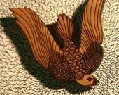 a pigeon brooch