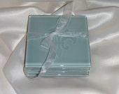 Fleur de Lis etched glass coasters in light blue/teal color
