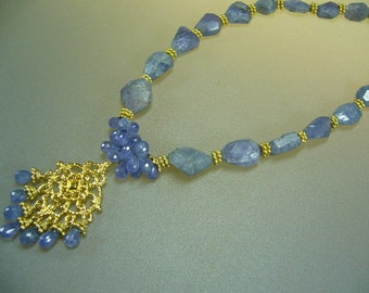 Faceted tanzanite gold necklace