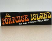 Porpoise Island Tennessee vintage bumper sticker dolphin sea creature polynesian tiki orange yellow black white Hawaiian amusement park