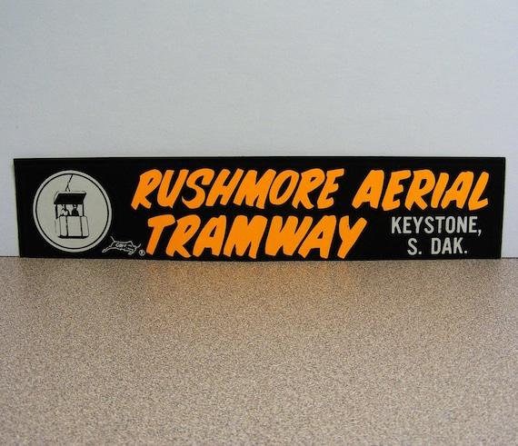 Rushmore Aerial Tramway vintage bumper sticker keystone south dakota black orange white