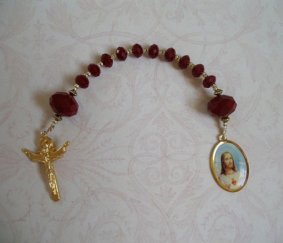 Red single decade rosary with Holy Trinity and Sacred Heart