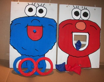 Elmo and Cookie   moster toss  games