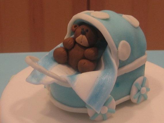 Edible fondant blue baby stroller/carriage cake topper.