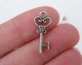 12 Key charms  antique silver tone K24