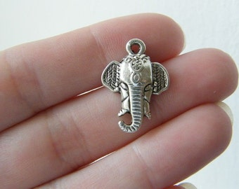 6 Elephant head charms antique silver tone A529