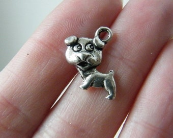 8 Dog charms antique silver tone D29