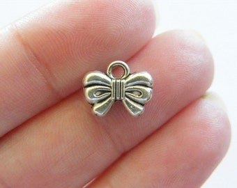 10 Bow charms tibetan silver CT136