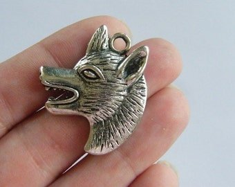 4 Wolf charms antique silver tone A288