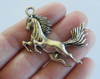2 Horse pendants antique silver tone A598
