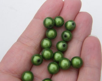 20 Green miracle beads