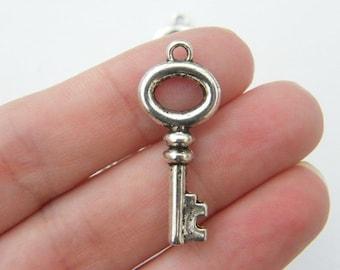 6 Key charms tibetan silver K56
