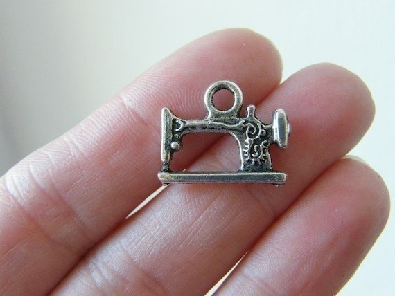 8 Sewing machine charms antique silver tone SN43