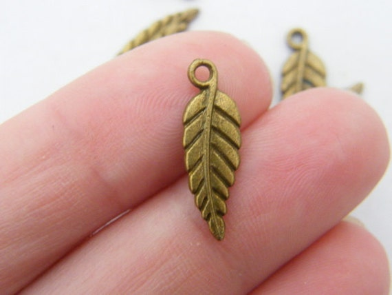 10 Leaf charms ( double sided ) 19 x 6mm antique bronze tone ( FREE combined shipping )