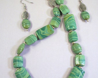 Silver and Swirling Green Puffed Glass Necklace/ Earrings
