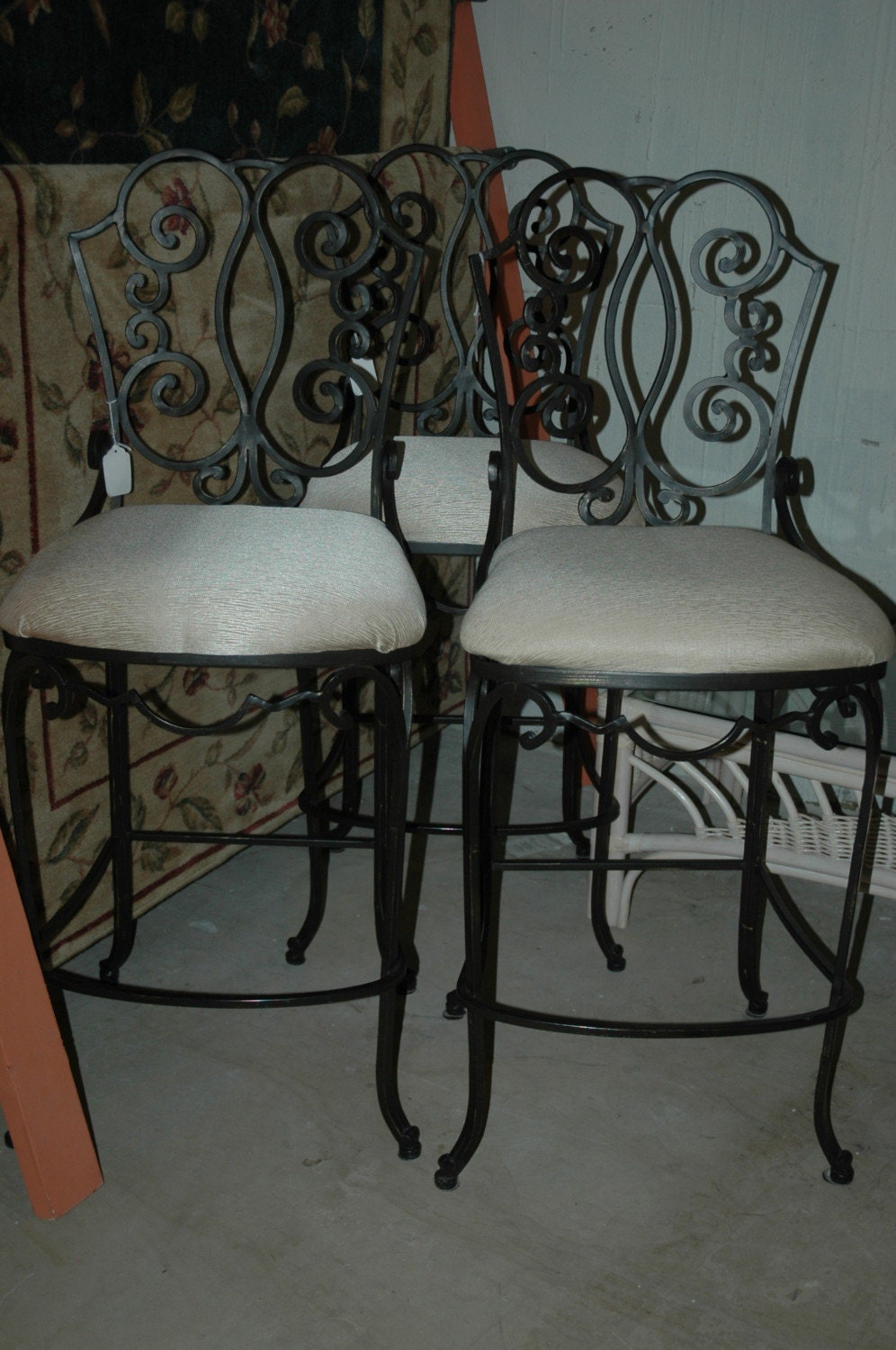 Scrolled heavy wrought iron bar stools ecru color cushions