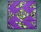 Quilted table mat - purple and green