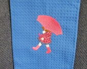 Embroidered hand towel - blue with girl and umbrella