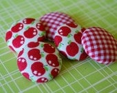 Apple fabric buttons.