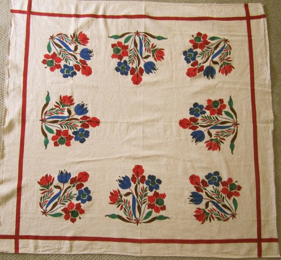 TABLECLOTH of Natural fabric w printed flowers in red green blue