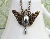 GUARDIANS, antique brass dark angel necklace with vintage glass cab