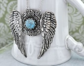 EDEN, antique silver large winged pendant with vintage turquoise glass cab