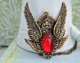 SERAPHIM six winged angel necklace in antique brass with vintage ruby red glass cab