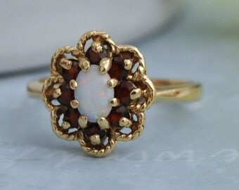 VINTAGE FIND 10k gold ring with opal and red garnet gemstones size 5.75