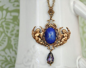 STAR Is MY GUIDANCE antique brass necklace with vintage blue starlit glass cab