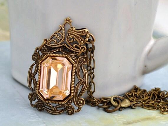 VINTAGE SPARKLE, Victorian style antique brass necklace with  vintage peach color Swarovski glass jewel